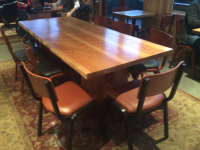 A natural wood table on display at the buzz coffee house